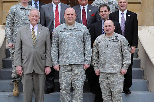 Rock Island Arsenal senior leadership and Quad Cities area mayors gather on the steps of Quarters One at Rock Island Arsenal, Ill., April 2. (Photo by Sgt. 1st Class Shannon Wright, ASC Public Affairs)