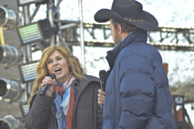 "Actors Connie Britton and Will Chase �"" who portray Rayna James and Luke Wheeler on �""Nashville"" �"" speak to the crowd between reshoots of a Fort Campbell concert scene that will be featured when the show airs May 7 on ABC."