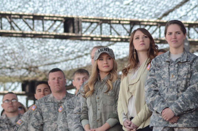 "Second Lt. Erin Rademaker, 1st Battalion, 320th Field Artillery Regiment, 2nd Brigade Combat Team, (right) stands with actress Hayden Panettiere (center) and other Fort Campbell Soldiers and Family members at Sabre Army Airfield, March 26, during a staged concert. Panettiere was on post filming last week with the ABC hit show, �""Nashville."" She plays rising country music star Juliette Barnes."