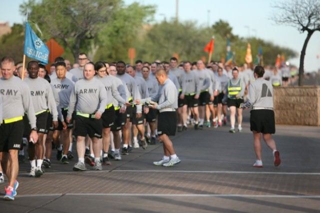 Sgt. 1st Class Michael Adye and Staff Sgt. Jennifer Soto, Fort Huachuca victim advocates, call out motivational and inspirational slogans and pass out educational material during the Walk of Respect on Warrior-Sentinel Field Tuesday. The walk was held...