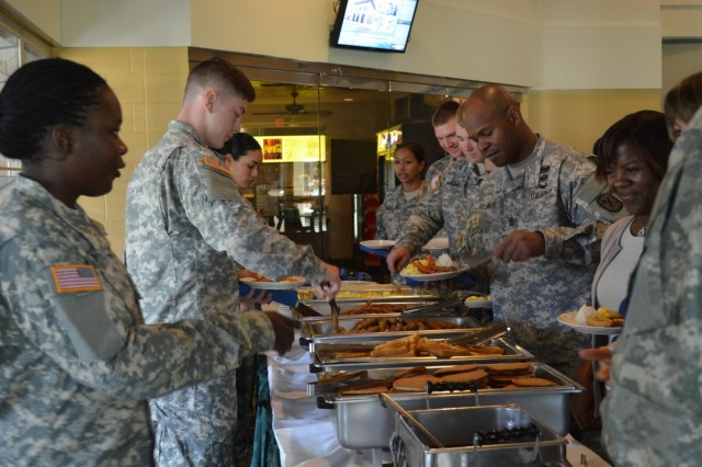 Soldiers and family members of the 45th Sustainment Brigade fill their plates during a prayer breakfast at the Leilehua Golf Course, Wahiawa, Hawaii, April 2. The event included a hot meal, inspiring speeches, and prayers for Soldiers for their upcoming deploying to Afghanistan. (U.S. Army photo by Spc. Erin Sherwood, 45th Sustainment Brigade Public Affairs)
