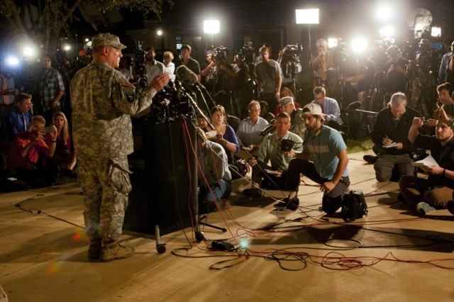 Lt. Gen. Mark A. Milley, III Corps and Fort Hood commanding general, takes questions from reporters during a press conference just outside the main gate of Fort Hood, Texas, April 2. Milley confirmed that 16 people were wounded and four killed, including the alleged assailant, during a shooting spree on post that afternoon. (U.S. Army photo by Sgt. Ken Scar, 7th Mobile Public Affairs Detachment)