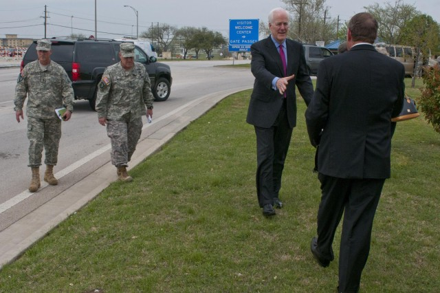 U.S. Sen. John Cornyn greets Killeen Mayor Dan Corbin before a press conference outside the main gate of Fort Hood, April 3, 2014. U.S. Lt. Gen. Mark A. Milley, III Corps and Fort Hood commanding general, and Maj. Gen. James M. Richardson, III Corps and Fort Hood deputy commanding general, are following Cornyn on the left. (U.S. Army photo by Sgt. Ken Scar, 7th Mobile Public Affairs Detachment)