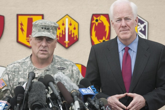 U.S. Army Lt. Gen. Mark A. Milley, III Corps and Fort Hood commanding general, addresses the media with U.S. Sen. John Cornyn during a press conference concerning the April 2 shooting on Fort Hood, April 3, 2014. (U.S. Army photo by Sgt. Ken Scar, 7th Mobile Public Affairs Detachment)