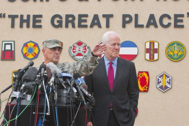 U.S. Army Lt. Gen. Mark Milley, III Corps and Fort Hood commanding general, and U.S. Sen. John Cornyn take questions from reporters during a press conference addressing the April 2 shooting on Fort Hood, April 3, 2014. (U.S. Army photo by Sgt. Ken Scar, 7th Mobile Public Affairs Detachment)
