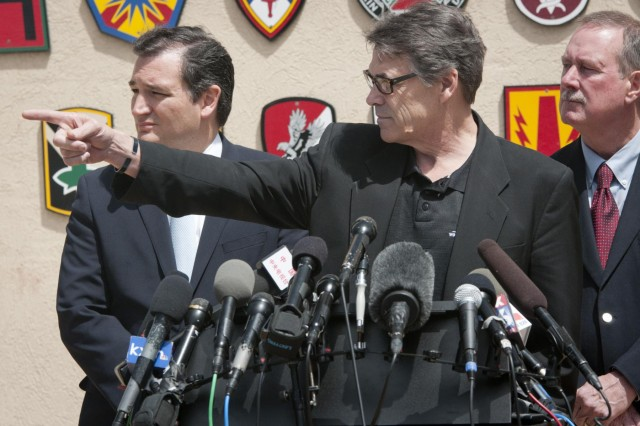 Texas Gov. Rick Perry takes questions from reporters during a press conference in front of the Fort Hood main gate April 4, 2014. Perry and Sen. Ted Cruz held the conference to address the April 2 shooting on the base. (U.S. Army photo by Sgt. Ken Scar, 7th Mobile Public Affairs Detachment)