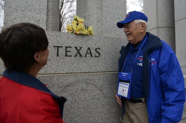 Army World War II veteran James Marquardt and his Honor Flight escort Joan Patmore are seen at the Texas state marker at the National World War II Memorial in Washington, D.C., April 4, 2014. The pair was part of an Honor Flight that arrived earlier in the day from Dallas-Fort Worth.