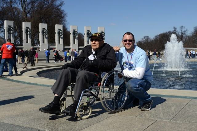 World War II Army veteran Ira Morehart, of the 101st Airborne, traveled on an Honor Flight from Columbus, Ohio, accompanied by his grandson Jason Kilmer, to visit the World War II Memorial in Washington, D.C., April 5, 2014.