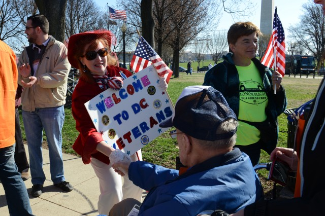 Dawn Jones, who lives in the D.C. area, says she comes out as much as she can to greet veterans on Honor Flights. Here, she greets a veteran at the World War II Memorial in Washington, D.C., April 5, 2014.