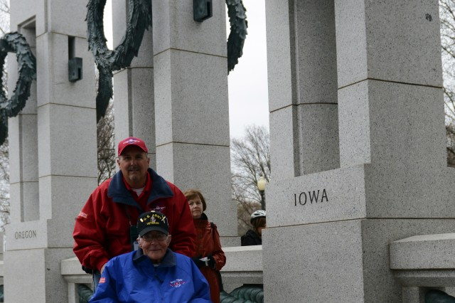 World War II Army veteran Bob Martin is accompanied by his son Glenn Martin during a Honor Flight visit to the World War II Memorial in Washington, D.C., April 4, 2014. The father-son team traveled to the nation's capital on a Honor Flight from Dallas-Fort Worth.