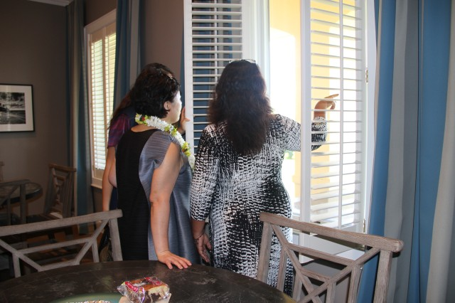 Anita Clingerman (right), Fisher House manager, shows off the views outside a window from Fisher House II to Hyun Sook Lee (left), spouse of Gen. Yo Hwan Kim, Commanding General, 2nd Operational Command, Republic of Korea (ROK) Army, along with other visitors from ROK while visiting with residents of the comfort home at Tripler Army Medical Center on April 4, 2014.