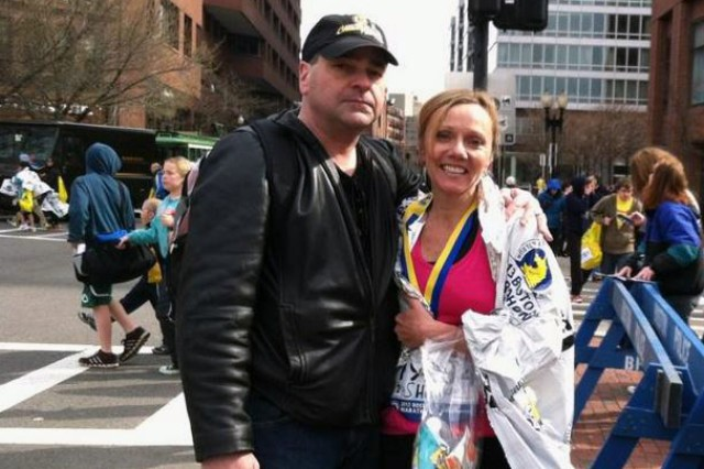 Shivaun Pacitto of Natick Soldier Research, Development and Engineering Center, Mass., stands with husband Gary Pacitto, after the finish of last year's Boston Marathon. Shivaun will be back to run the race despite last year's bombing.