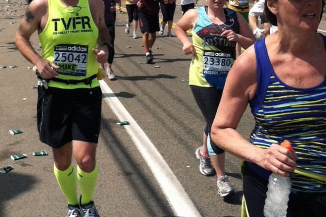 Mike Nixon of the Natick Soldier Research, Development and Engineering Center, Mass., runs along the Boston Marathon course during last year's race.