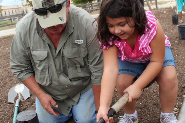Mike Kancilja and his granddaughter Sabrie Ramirez volunteer their time to lay mulch, compost and plants at Fort Hood�'s bird, bee, butterfly and bat garden.  Volunteers from Fort Hood, Keep Copperas Cove Beautiful, Copperas Cove 4-H and the City of Copperas Cove volunteered 135 hours.  The garden was made possible by a grant received from the National Public Lands Day Department of Defense Legacy Award.