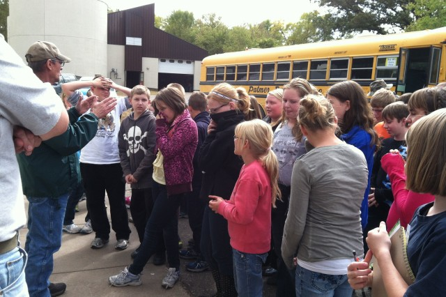 Morrison County Water Festival brings about 500 sixth graders to  Camp Ripley to learn about water resource management. Here the students are learning about the operation of the Camp Ripley wastewater treatment plant.  Zac Alexander and Mark Erickson from the EQ team are shown instructing the students.