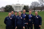 Soldier-athletes who competed in the 2014 Winter Olympics and Paralympics pose on the South Lawn of the White House, April 3, 2014. From left to right are: Sgt. Matthew Mortensen; luge coach Staff Sgt. William Tavares (in suit); Sgt. Preston Griffall; Sgt. Justin Olsen; Staff Sgt. Jen Lee; Capt. Christopher Fogt; and Sgt. Nicholas Cunningham. (Not pictured, Sgt. Dallas Robinson)