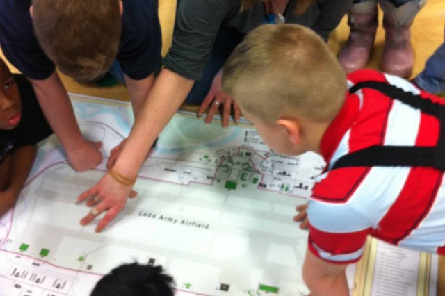 As part of Fort Wainwright's Earth Day celebrations, the CRMP's Architectural Historian taught school-age children about Fort Wainwright's history. She talked with the students about historic Ladd Field while showing maps and historic photographs.