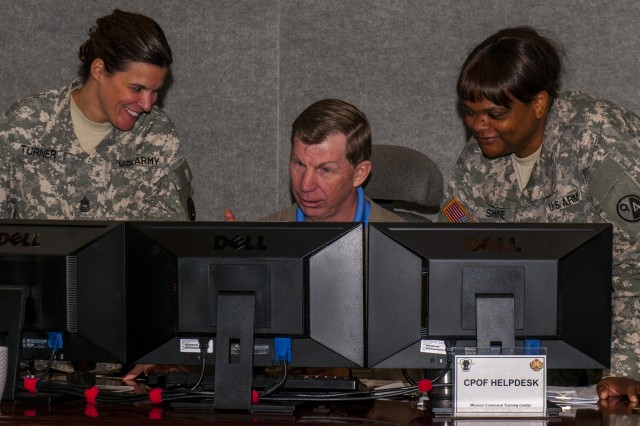 (L) Master Sgt. Sherri Turner, course manager, Human Resources Specialist Course, and Master Sgt. Ethel B. Shine the course�'s chief instructor, both assigned to 5th Battalion, 4th Brigade, 94th Training Division Decatur, Ga. interact with Randall D. Williams, senior instructor Mission Command Training Center, Fort Knox, regarding the operation of a command and control software interface called the Command Post of the Future, Fort Knox, Ky. April 24, 2014. CPOF allows commanders in combat to view a battlefield in real-time and collaborate with superiors, peers and subordinates over live data.
