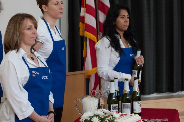 BSCS members, from left, Maggie Konopa, Jaime Waterbury, Krystal Joslin volunteer during the Dining at the Ritz event, in which they invite community students to attend a formal luncheon in their honor.