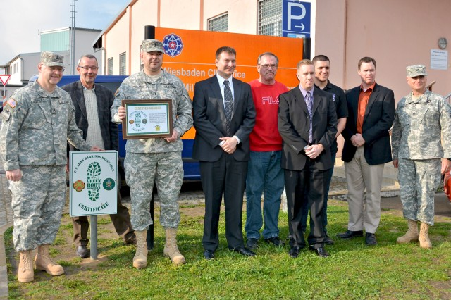 Col. David Carstens (right), U.S. Army Garrison Wiesbaden commander, recognizes the accomplishments of the 481st Military Police Detachment (Crinimal Investigation Division) in earning the coveted Green Boot Certificate.