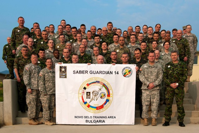 Pictured here are personnel who participated in the Saber Guardian 2014 Multinational Brigade. Hosted by U.S. Army Europe, and the Bulgarian Land Forces, Saber Guardian 2014 is a multinational military exercise involving approximately 700 military personnel from twelve participating nations including Armenia, Azerbaijan, Belgium, Bulgaria, Georgia, Moldova, Poland, Romania, Serbia, Ukraine, Turkey and the U.S., as well as representatives from NATO. The exercise, which ran until April 4, 2014, was designed to strengthen international agency and military partnering while fostering trust and improving interoperability between NATO and partner nations involved in foreign consequence management and peace support operations with U.S. forces. Saber Guardian 2014 is part of the U.S. Army Europe annual training and exercise program and has been planned for since 2013. Last year's iteration of the training exercise was conducted at the Romanian Land Forces Combat Training Center in Cincu, Romania. The training at Saber Guardian 2014 will reinforce USAREUR's commitment to increasing regional flexibility, preserving and enhancing NATO interoperability, and facilitating multinational training.