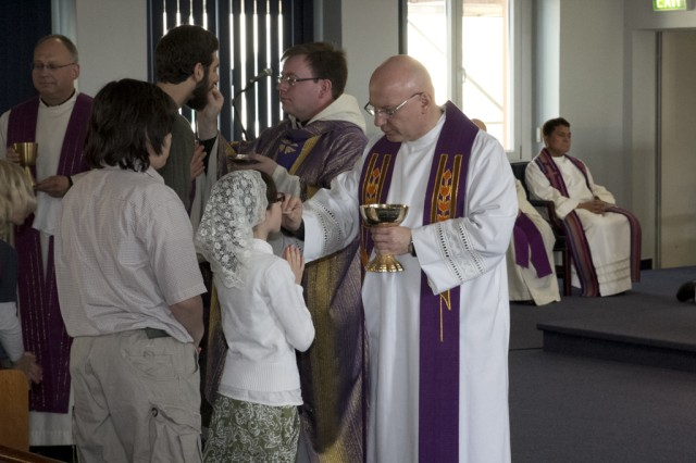 Fathers Thomas Gricoski and Kopec serve the Eucharist to USAG Ansbach parishioners during a Clergy Day event April 7, 2014, at Katterbach, Germany.