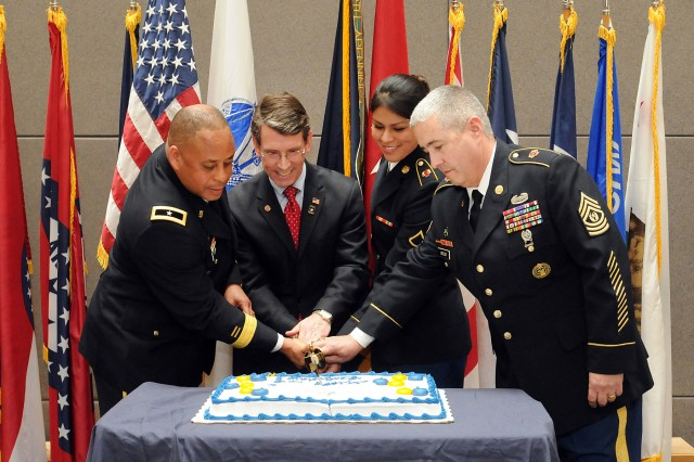 From left to right, Brig. Gen. Gracus K. Dunn, Commanding General, 85th Support Command and Deputy Commanding General for Support, First Army Division-West; Mayor Thomas Hayes, Mayor of Arlington Heights, Ill., and former West Point U.S Military Academy graduate; Pfc. Yvette Leon, Human Resources Specialist, and the command's most junior soldier; and Command Sgt. Maj. Kevin Greene, Command Sergeant Major, 85th Support Command and senior enlisted soldier cut a cake during the 106th birthday celebration of the Army Reserve at the unit's headquarters near Chicago on Apr. 5. (U.S. Army photo by Sgt. 1st Class Anthony L. Taylor/Released)