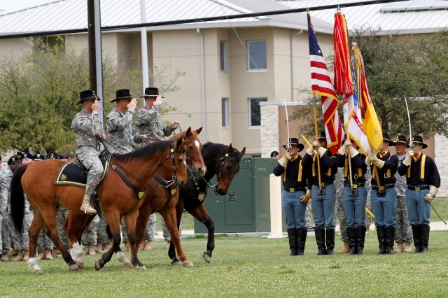 "Col. John DiGiambattista (left on horseback), the incoming commander of the 1st �""Ironhorse"" Brigade Combat Team, 1st Cavalry Division; Col. Steve Gilland (center on horseback), the outgoing Ironhorse commander; and Brig. Gen. Michael Bills, commander of the 1st Cavalry Division (right on horseback), salute the 1st Cavalry Division Honor Guard at the Ironhorse change of command and assumption of responsibility ceremony April 7 at Fort Hood, Texas. The brigade said farewell to Gilland and welcomed DiGiambattista and Command Sgt. Maj. Joseph Cornelison, the incoming senior noncommissioned officer of the brigade. (U.S.  Army photo by Spc. Paige Behringer, 1BCT PAO, 1st Cav. Div.)"
