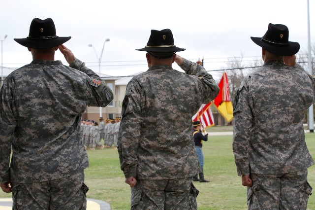 "From left to right: Col. Steve Gilland, outgoing commander of the 1st �""Ironhorse"" Brigade Combat Team, 1st Cavalry Division; Brig. Gen. Michael Bills, commander of the 1st Cavalry Division; and Col. John DiGiambattista, the incoming Ironhorse commander, salute the color guard during the pass in review portion of the Ironhorse change of command and assumption of responsibility ceremony April 7 at Fort Hood, Texas. The First Team Band, Soldiers from every Ironhorse battalion led by their commanders, the 1st Cavalry Division Honor Guard, and the 1st Cavalry Division Horse Detachment marched past the outgoing, incoming and division commanders during the ceremony. (U.S. Army photo by Spc. Paige Behringer, 1BCT PAO, 1st Cav. Div.)"
