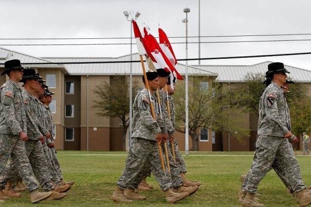 "Soldiers assigned to the 2nd �""Thunderhorse"" Battalion, 12th Cavalry Regiment, 1st �""Ironhorse"" Brigade Combat Team, 1st Cavalry Division cross Cooper Field in front of the incoming and outgoing leadership during the pass in review portion of the Ironhorse change of command and assumption of responsibility ceremony April 7 at Fort Hood, Texas. During the ceremony, Soldiers from every Ironhorse battalion, led by their commanders, marched past the outgoing and incoming leadership. (U.S.  Army photo by Spc. Paige Behringer, 1BCT PAO, 1st Cav. Div.)"