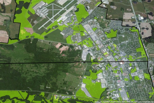 "Green areas represent ""cleared parcels"" compared to aerial images of Fort Campbell, Ky."