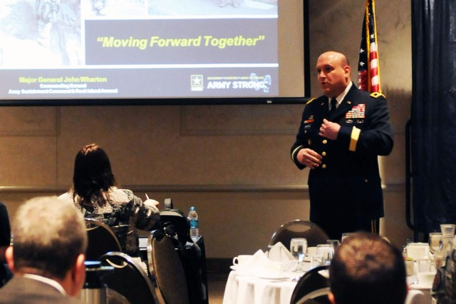 Maj. Gen. John Wharton, commanding general of U.S. Army Sustainment Command and senior mission commander of Rock Island Arsenal, Ill., speaks at the Quad Cities Chamber Executives Club breakfast at the iWireless Center in Moline, Ill., April 4. (Photo by Sgt. 1st Class Shannon Wright, ASC Public Affairs)