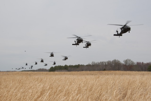 """UH-60 Black Hawk helicopters from 5th Battalion, 101st Combat Aviation Brigade """"Wings of Destiny,"""" transport Soldiers from the 3rd Battalion, 187th Infantry Regiment, 3rd Brigade Combat Team """"Rakkasans,"""" 101st Airborne Division (Air Assault), on to Landing Zone Red Crow, during Operation Golden Eagle at Fort Campbell, Ky., April 8, 2014.The four-day exercise was the first brigade-size air assault operation conducted by the 101st Airborne Division in more than a decade, and featured Soldiers from 3rd Brigade Combat Team and 101st Combat Aviation Brigade moving more than 1,100 Soldiers and sling-loading more than 20 pieces of equipment."""