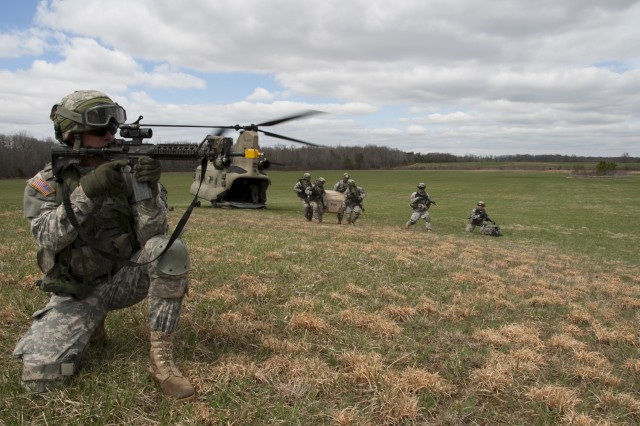"""Soldiers with 3rd Battalion, 320th Field Artillery Regiment, 3rd Brigade Combat Team """"Rakkasans,"""", 101st Airborne Division (Air Assault), secure a landing zone during the full dress rehearsal for Operation Golden Eagle at Fort Campbell, Ky., April 4, 2014. The four-day exercise was the first brigade-size air assault operation conducted by the 101st Airborne Division in more than a decade, and featured Soldiers from 3rd Brigade Combat Team and 101st Combat Aviation Brigade moving more than 1,100 Soldiers and sling-loading more than 20 pieces of equipment."""