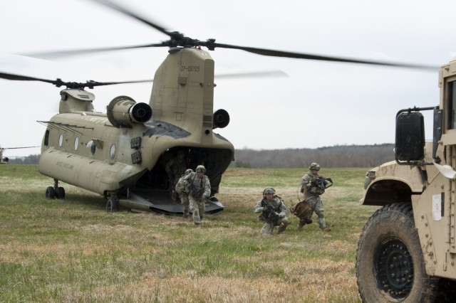 "Soldiers from 3rd Battalion, 187th Infantry Regiment, 3rd Brigade Combat Team ""Rakkasans,"" 101st Airborne Division (Air Assault), Air Assault into Landing Zone Red Crow during Operation Golden Eagle at Fort Campbell, Ky., April 8, 2014. The four-day exercise was the first brigade-size air assault operation conducted by the 101st Airborne Division in more than a decade, and featured Soldiers from 3rd Brigade Combat Team and 101st Combat Aviation Brigade moving more than 1,100 Soldiers and sling-loading more than 20 pieces of equipment."