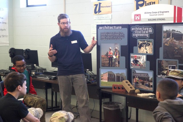 """Craig Walters, a civil engineer with the U.S. Army Corps of Engineers Savannah District, Fort Stewart Resident Office, talks to students at Diamond Elementary School about engineering careers with the Corps during a school-wide """"STEMposium"""" April 4, 2014. The event focused on getting children interested in Science, Technology, Engineering and Math (STEM) career fields. (USACE photo by George Jumara)"""
