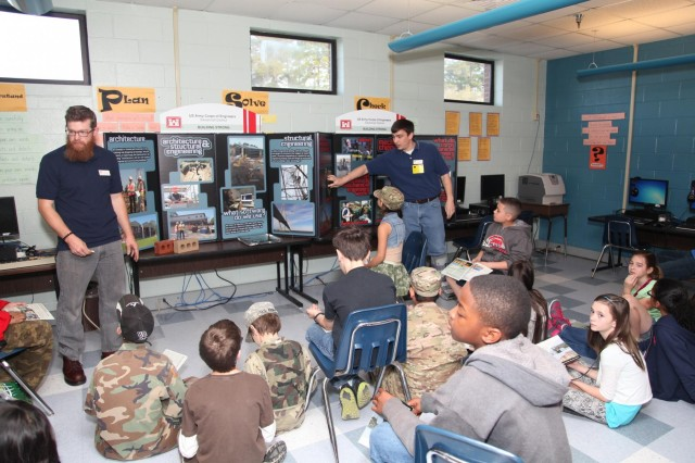 """Civil Engineer Craig Walters (left) and Mechanical Engineer Matt Kilmer with the U.S. Army Corps of Engineers Savannah District, Fort Stewart Resident Office, talk to students at Diamond Elementary School about engineering careers with the Corps during a school-wide """"STEMposium"""" April 4, 2014. The event focused on getting children interested in Science, Technology, Engineering and Math (STEM) career fields. (USACE photo by George Jumara)"""