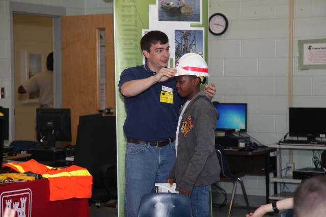 """Matt Kilmer, a mechanical engineer with the U.S. Army Corps of Engineers Savannah District, Fort Stewart Resident Office, demonstrates the importance of safety on a job site during a school-wide """"STEMposium"""" at Diamond Elementary School, April 4, 2014. The event focused on getting children interested in Science, Technology, Engineering and Math (STEM) career fields. (USACE photo by George Jumara)"""