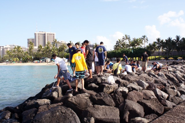 HONOLULU (APRIL 5, 2014) - Approximately 30 volunteers from the Punahou Junior ROTC program (which includes cadets from other area high schools and some homeschooled students) and Corps' employees and family members joined forces April 5 to clean up the beach and berm area at the Corps' Pacific Regional Visitor Center at Fort DeRussy in Waikiki. Altogether about 45 volunteers participated in this Earth Month event.
