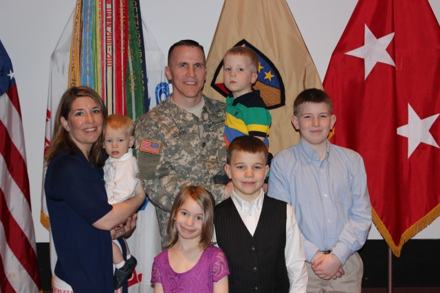 Maj. Steven Dyer of Stratford, Conn., drove more than two days with his family to attend Friday's ceremony in Bob Jones Auditorium. He's holding son Silas, 3. The other family members are, from left, wife Stephanie with son Emerson, 1, daughter Marin, 7, son Oliver, 9, and son Aiden, 12.