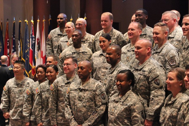 The acquisition workforce selectees, all members of the Army Reserve, gather for group photos after the ceremony.