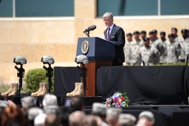 """Secretary of the Army John McHugh delivers a speech April 9 during a memorial ceremony conducted at Fort Hood, Texas in honor of the Soldiers who died during the April 2 shooting incident. (Photo by Staff Sgt. Gregory Sanders, 85 Civil Affairs Brigade Public Affairs """" Release by III Corps and Fort Hood Public Affairs Office)"""