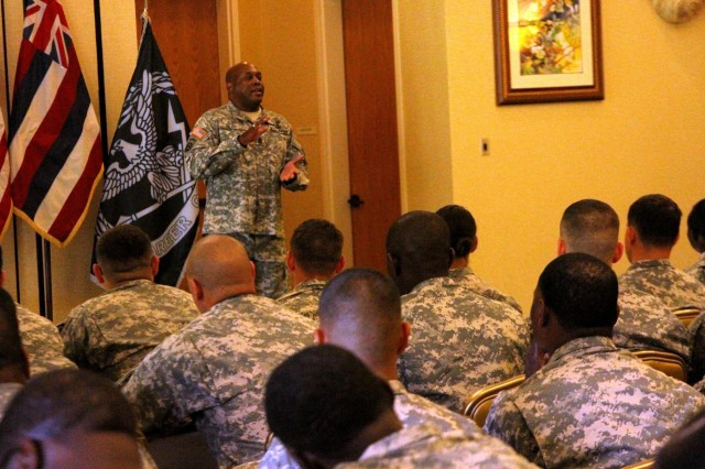 Command Sgt. Maj. Nathan Hunt, the senior enlisted adviser for the 8th Theater Sustainment Command, speaks to nearly 140 Soldiers from commands across Hawaii and Japan at the annual United States Army Pacific Command's Mobile Retention Training Team training, April 4, hosted by the 8th TSC at Schofield Barracks, Hawaii.