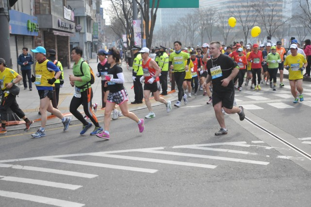 SEOUL, South Korea - Spc. Joshua Sisco, a multiple launch rocket system crewmember with B Battery, 1st Battalion, 38th Field Artillery Regiment, 210th Field Artillery Brigade, 2nd Infantry Division and a native of Tulsa, Okla., runs the Seoul International Marathon March 16, 2014 with more than 44,000 people in downtown Seoul, South Korea. (U.S. Army photo by Capt. Kelly McKenzie, 210th Field Artillery Brigade Public Affairs/Released)