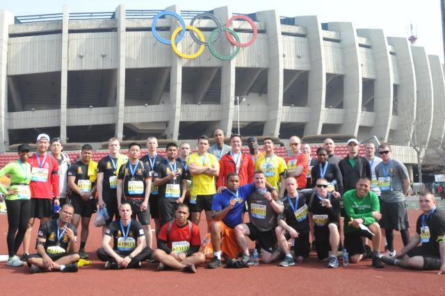 SEOUL, South Korea - Soldiers from the 1st Battalion, 38th Field Artillery Regiment, 210th Field Artillery Brigade, 2nd Infantry Division marathon team celebrate completing the Seoul International Marathon, March 16, 2014, at Olympic Stadium in Seoul, South Korea. (U.S. Army photo by Capt. Kelly McKenzie, 210th Field Artillery Brigade Public Affairs/Released)