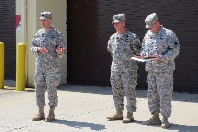 Lt. Col. Paul Gunnison (left), a native of Phoenix, Ariz., and the current Squadron Commander for 3rd Squadron, 1st Cavalry Regiment, 3rd Armored Brigade Combat Team, 3rd Infantry Division, speaks to his Soldiers March 24, during the award presentation of the Army Award of Maintenance Excellent (AAME), 2nd runner-up. The squadron was recordized with the award for this excellence in maintenance during fiscal year 2012. Gunnison congratulated the Soldiers and encouraged them to continue to achieve excellence every day.  (Photo by 2nd Lt. Brian Baier, 3rd Squadron, 1st Cavalry Regiment)