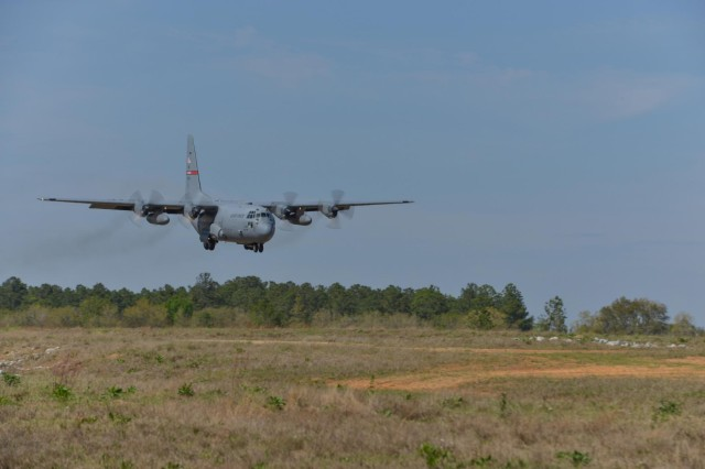A C-130H Hercules aircraft from the 165th Airlift Wing, Georgia Air National Guard performs a combat short field landing on a dirt airstrip, April 2, 2014 at Remagen Landing Zone in Fort Stewart, Ga. The revitalized 5,000 foot airstrip hasn't accommodated heavy cargo aircraft in over 20 years. (U.S. Air National Guard photo by Master Sgt. Charles Delano/released)