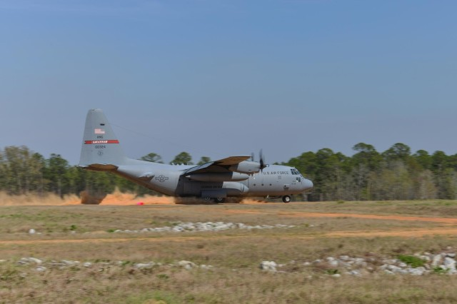 A C-130H Hercules aircraft from the 165th Airlift Wing, Georgia Air National Guard performs a combat short field landing on a dirt air strip, April 2, 2014 at Remagen Landing Zone in Fort Stewart, Ga. The revitalized 5,000 foot airstrip hasn't accommodated heavy cargo aircraft in over 20 years. (U.S. Air National Guard photo by Master Sgt. Charles Delano/released)