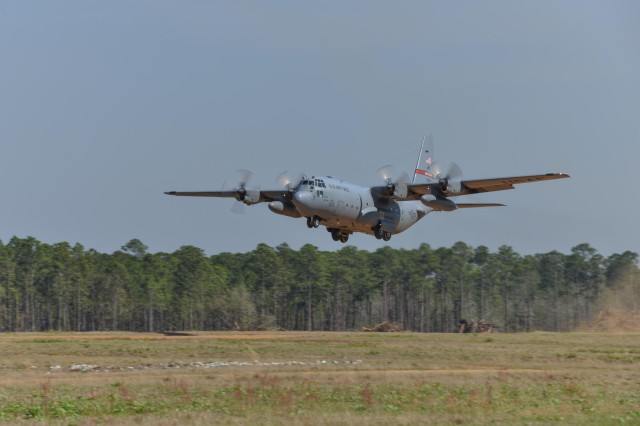A C-130H Hercules aircraft from the 165th Airlift Wing, Georgia Air National Guard performs a combat short field take-off on a dirt airstrip, April 2, 2014 at Remagen Landing Zone in Fort Stewart, Ga. The revitalized 5,000 foot airstrip hasn't accommodated heavy cargo aircraft in over 20 years. (U.S. Air National Guard photo by Master Sgt. Charles Delano/released)