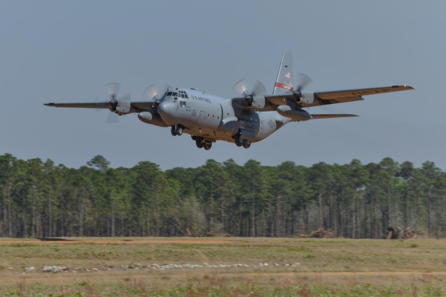 A C-130H Hercules aircraft from the 165th Airlift Wing, Georgia Air National Guard performs a combat short field take-off on a dirt airstrip, April 2, 2014, at Remagen Landing Zone in Fort Stewart, Ga. The revitalized 5,000 foot airstrip hasn't accommodated heavy cargo aircraft in over 20 years. (U.S. Air National Guard photo by Master Sgt. Charles Delano/released)